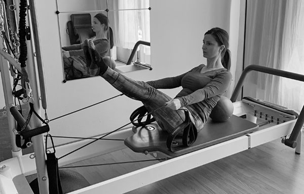 ASPIRE Pilates client exercising in studio